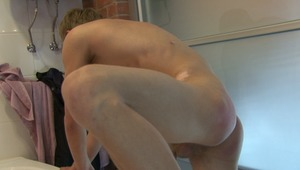 charming flower boyfriend gets his naked butt spanked by gay master at the side of the bathtub in hardcore bdsm film.