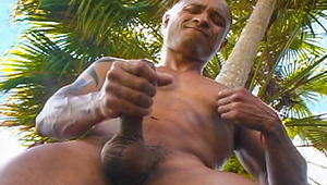 stunning, sensuous Mario Cruz gives a solo in a lush garden