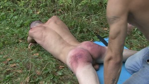 Gay lord still continues to beat twinks bruised behind even when he is screaming with pain in naughty bdsm sex.