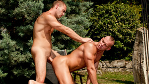 Both dudes moan as Enrico continues working Zsolt's tight booty!