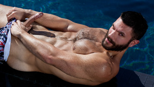 Bearded cutie Bob Hager jerks off in a pool on a sunny day