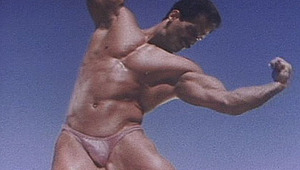 lovely beefy gay guy shows his athletic muscles to the camera