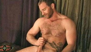 Tattoed man having some hot solo masturbation fun here