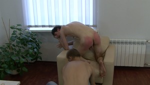 dirty lord takes pleasure in pounding young gay guys bruised ass with a wooden spoon on the couch.