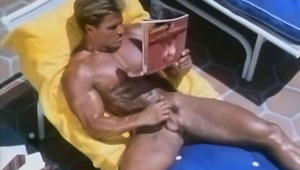 Hot businessman getting his penis hard over a gay magazine