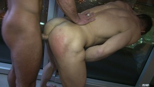 Villain Tomas Brand flips on the light of his Penthouse suite to find Secret Agent Paddy O'Brian  waiting with a loaded gun.  The actions quickly turns to the other loaded gun in the room - Paddy's hot cock that he uses to teach Tomas' bubble butt the mea