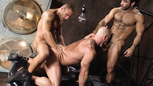 three horny very masculine males having sex in industrial set