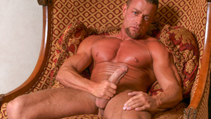 humongous male Tyler flexes his bulging muscles while jerking