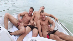The triplets jerkin off their dick in a boat on a boring day