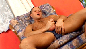 Handsome dude lay down on the floor to play with his penis