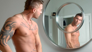Studly masculine firefighter Kevin jacks off in the mirror