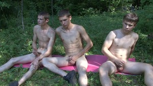 pretty gay twink boys are tugging their horny male penii zealously during outdoor gay group sex.