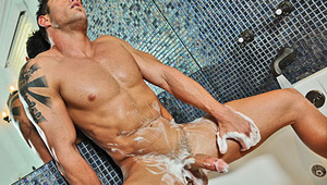 Cody shaves himself before stroking his dick in the bath.